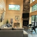 Sitting area featuring the 3-story stone fireplace.