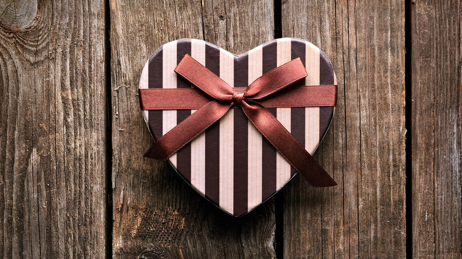 Heart-shaped box with ribbon.