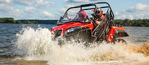 ATV driving through water.