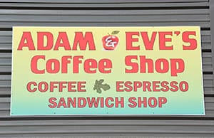Adam & Eve's Coffee Shop sign. Text: Coffee, espresso, sandwich shop.